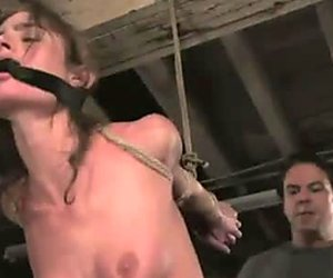 Slender tied up brunette babe Naomi is fucked by brutal master