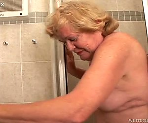 Obese blond haired granny with big boobs sucks long cock greedily