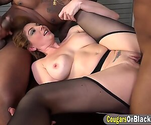 Busty cougar is taking in a fully loaded black anaconda