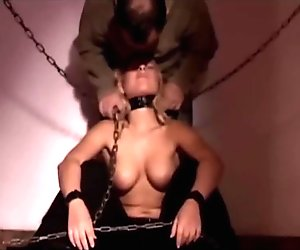 Girl restrained in chains is carnal used in bdsm equipped room