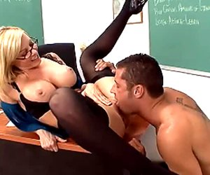 Blonde teacher Holly Sampson is screwed by her student in a doggy position