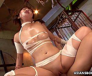 Gorgeous Asian redhead is bandaged and gangbanged