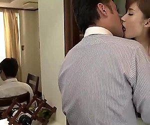 Cute Asian MILF Yuna Hayashi sucks huge cock in a kitchen