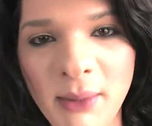 Buxom dark haired shemale in sexy stockings pleases herself in front camera