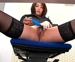 Shameless Asian office whore Maki Hojo masturbates at her desk