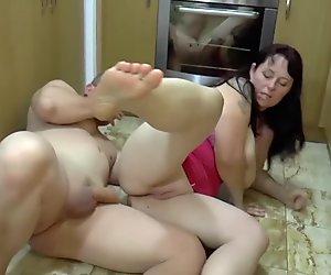 busty bbw stepmom gives footjob