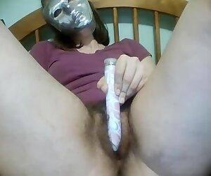 A Masked Masturbator Fiddles Her Hairy Bush