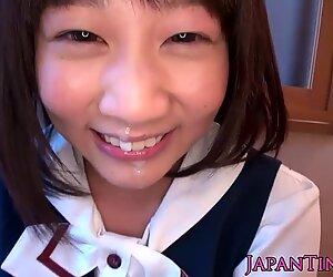 Tiny Japanese girl on knees sucking cock