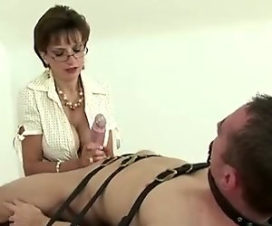 Prodomme jerking an useless cock