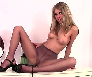 Blonde In Pantyhose Posing On Dresser