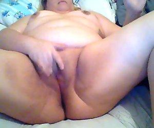 BBW slut masturbating while at her cousins.