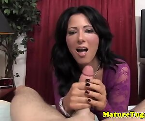 Beautiful busty stockinged MILF jacking cock