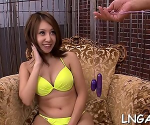 Honey Chinese spread her beautiful legs and got an orgasm from the vibrations of her big toy.