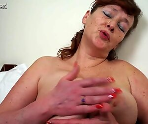 Naughty chubby grandma playing with her toy