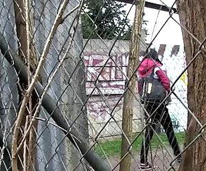 Raven haired dirty teen loves pissing on wire fence