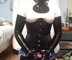 Latex Lola plays with dildos and bondage gear