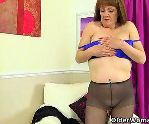 English gilf Pandora fucks her pantyhosed pussy with a dildo