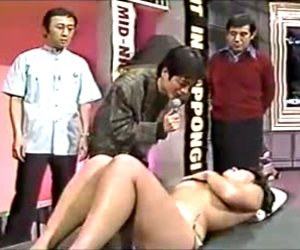 Japanese girl is being massaged by an old bloke