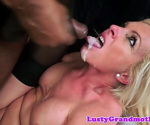Interracially fucked cougar in stockings