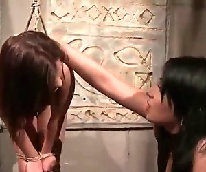Young mistress punishing her slavegirl