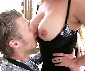 Busty blonde babe Joclyn Stone on her knees sucking dick